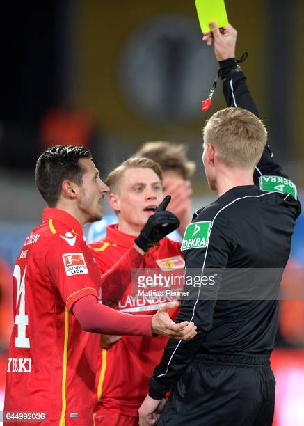 Steven Skrzybski Simon Hedlund of 1 FC Union Berlin and referee Timo Gerach during the game between dem 1 FC Union Berlin and dem TSV 1860 Muenchen...