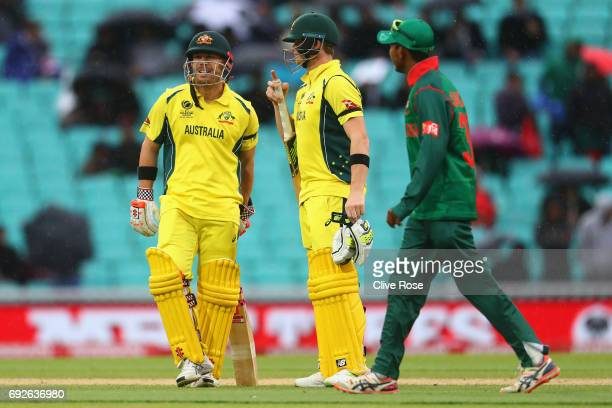 Steven Smith and David Warner of Australia look on as play is suspended for rain during the ICC Champions trophy cricket match between Australia and...