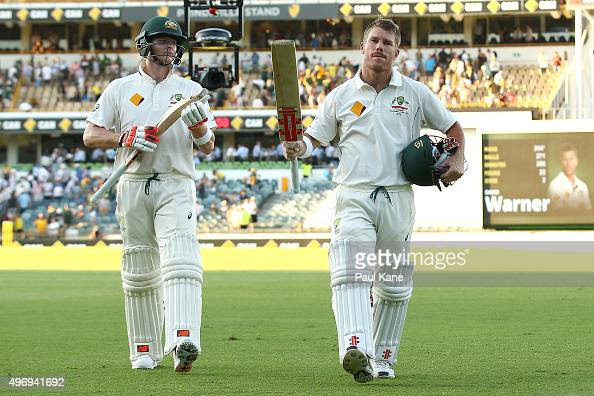 Steven Smith and David Warner of Australia walk from the field at the end of play during day one of the second Test match between Australia and New...