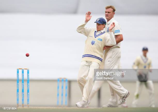 Steven Smith and Doug Bollinger of the Blues avoid a ball thrown at the stumps during day three of the Sheffield Shield match between the Victoria...