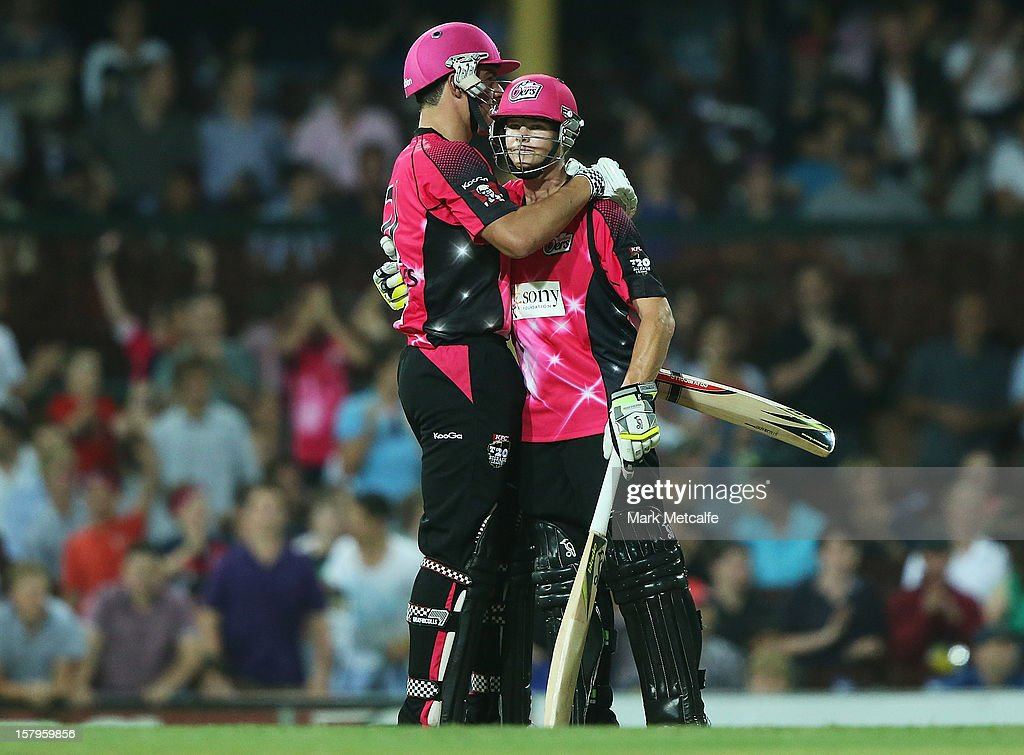 Steven Smith and Moises Henriques celebrate winning the Big Bash League match between the Sydney Sixers and the Sydney Thunder at Sydney Cricket Ground on December 8, 2012 in Sydney, Australia.