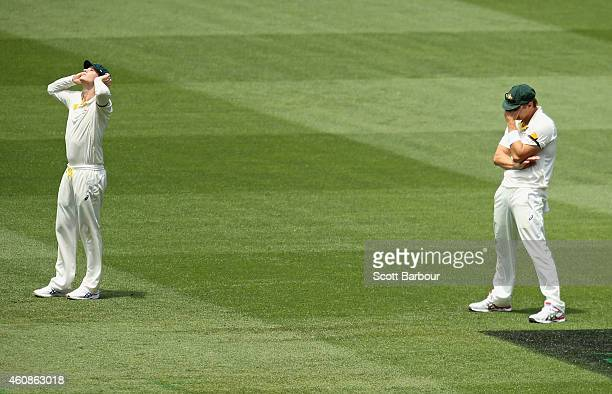 Steven Smith and Shane Watson of Australia react after Watson dropped catch during day three of the Third Test match between Australia and India at...