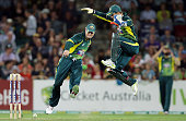 Steven Smith of Australia attempts a run out by kicking the ball at the stumps as Matthew Wade jumps out of the way during game three of the One Day...