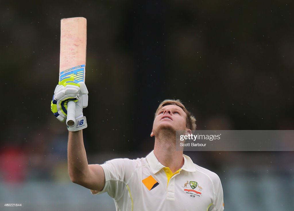 Steven Smith of Australia celebrates his century and pays tribute to the late Phillip Hughes during day two of the First Test match between Australia...