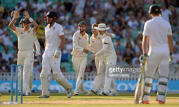 Steven Smith of Australia celebrates with teammates after dismissing England captain Alastair Cook during day three of the 5th Investec Ashes Test...
