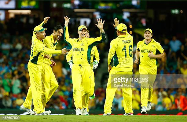 Steven Smith of Australia celebrates with teammates after taking the wicket of Ravindra Jadeja of India during the 2015 Cricket World Cup Semi Final...