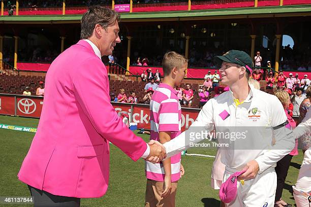 Steven Smith of Australia hands over his pink cap to Glenn McGrath on Jane McGrath day during day three of the Fourth Test match between Australia...