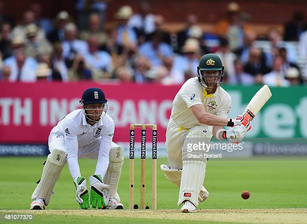 Steven Smith of Australia plays a shot during as England wicketkeeper Jos Buttler looks on day two of the 2nd Investec Ashes Test match between...