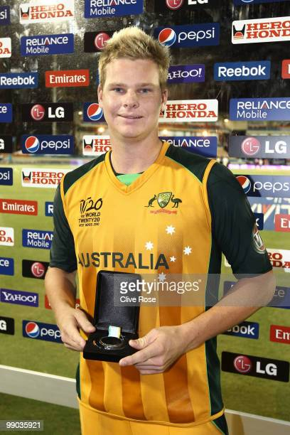Steven Smith of Australia poses with his man of the match award after the ICC World Twenty20 Super Eight match between West Indies and Australia at...