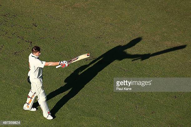 Steven Smith of Australia raises his bat to the players rooms to celebrate his century during day four of the second Test match between Australia and...
