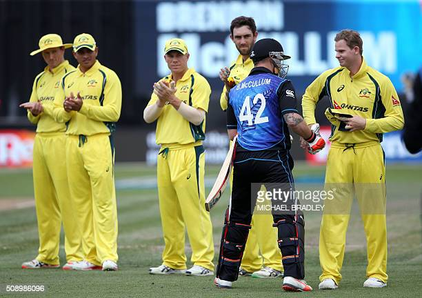 Steven Smith of Australia welcomes New Zealand's Brendon McCullum on the pitch at the start of the third oneday international cricket match between...