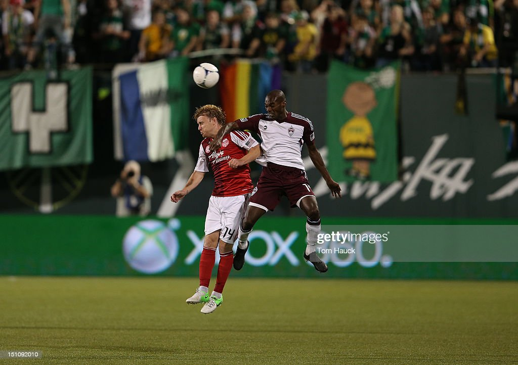 Steven Smith of Portland Timbers competes with Omar Cummings of Colorado Rapids on August 31 2012 at JeldWen Field in Portland Oregon