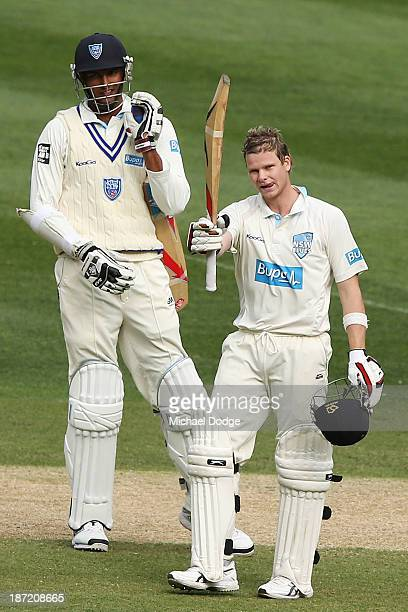 Steven Smith of the Blues celebrates his century next to Gurinder Sandhu during day two of the Sheffield Shield match between the Victoria...