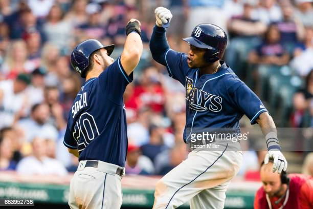 Steven Souza Jr #20 celebrates with Tim Beckham of the Tampa Bay Rays after both scored on a home run by Bekham during the sixth inning against the...