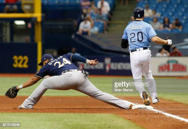 Steven Souza Jr #20 of the Tampa Bay Rays beats first baseman Jesus Aguilar of the Milwaukee Brewers to first base off his fielder's choice during...