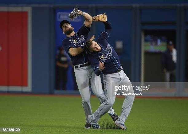 Steven Souza Jr #20 of the Tampa Bay Rays catches a fly ball as he collides with Daniel Robertson in the sixth inning during MLB game action against...