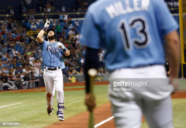 Steven Souza Jr #20 of the Tampa Bay Rays celebrates in front of teammate Brad Miller after hitting a tworun home run off of pitcher Corey Kluber of...
