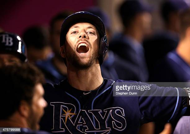 Steven Souza Jr #20 of the Tampa Bay Rays celebrates in the dugout after hitting a three run home run in the sixth inning against the Los Angeles...