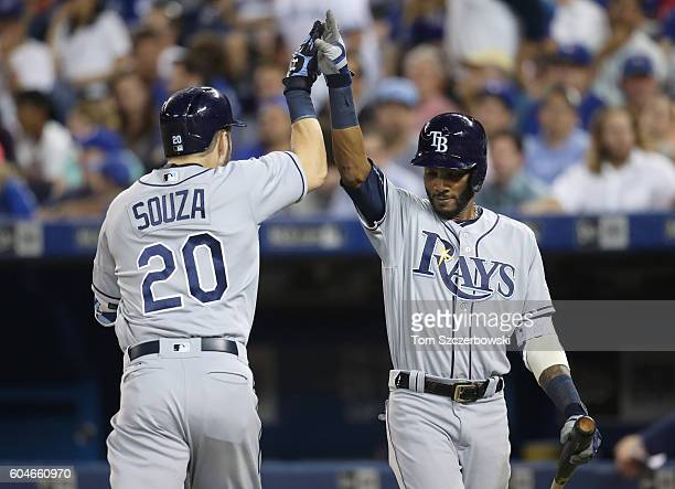 Steven Souza Jr #20 of the Tampa Bay Rays is congratulated by Alexei Ramirez after hitting a solo home run in the seventh inning during MLB game...
