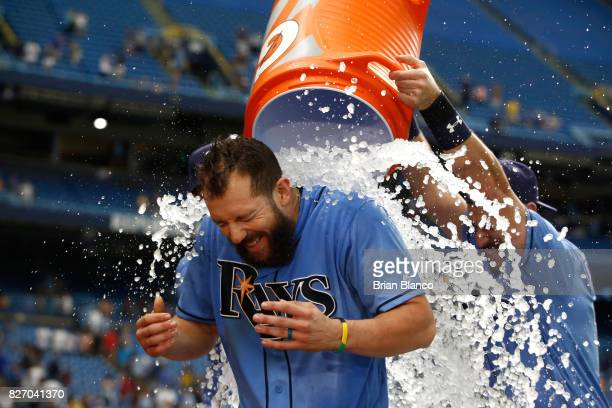Steven Souza Jr #20 of the Tampa Bay Rays is doused with ice by teammates after hitting a walkoff home run off of pitcher Jacob Barnes of the...