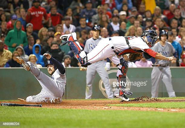 Steven Souza Jr #20 of the Tampa Bay Rays is out at the plate as Blake Swihart of the Boston Red Sox turns a double play in the seventh inning at...