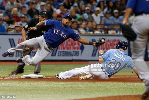 Steven Souza Jr #20 of the Tampa Bay Rays steals third base ahead of third baseman Adrian Beltre of the Texas Rangers during the fourth inning of a...