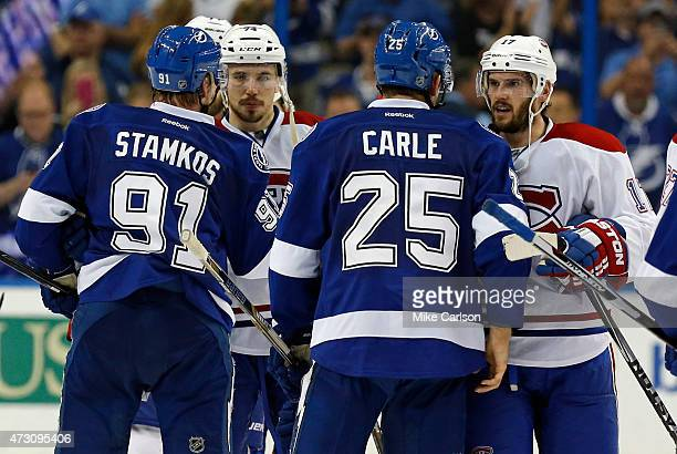 Steven Stamkos and Matt Carle of the Tampa Bay Lightning shake hands with Alexei Emelin and Torrey Mitchell of the Montreal Canadiens after Game Six...