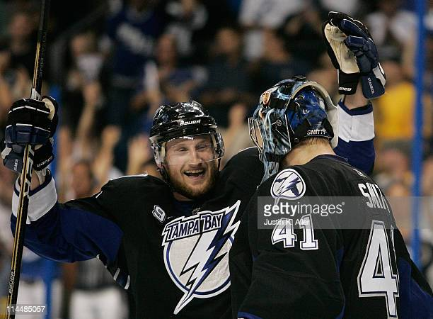 Steven Stamkos and Mike Smith of the Tampa Bay Lightning celebrate after defeating the Boston Bruins 5 to 3 in Game Four of the Eastern Conference...