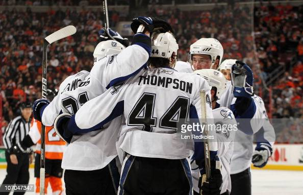 Steven Stamkos Nate Thompson and Martin St Louis of the Tampa Bay Lightning celebrate a second period goal on November 18 2010 at the Wells Fargo...