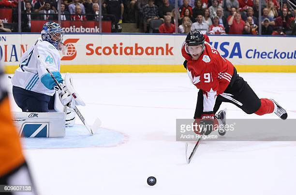 Steven Stamkos of Team Canada dives after a loose puck in front of Jaroslav Halak of Team Europe during the World Cup of Hockey 2016 at Air Canada...