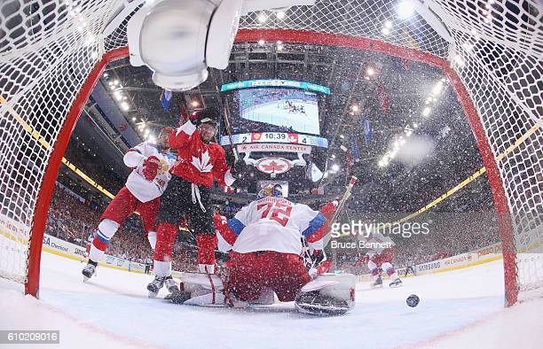 Steven Stamkos of Team Canada watches a third period goal by John Tavares against Sergei Bobrovsky of Team Russia at the semifinal game during the...