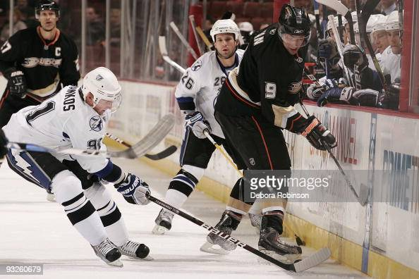 Steven Stamkos of the Tampa Bay Lighting reaches in for the puck against Bobby Ryan of the Anaheim Ducks during the game on November 19 2009 at Honda...