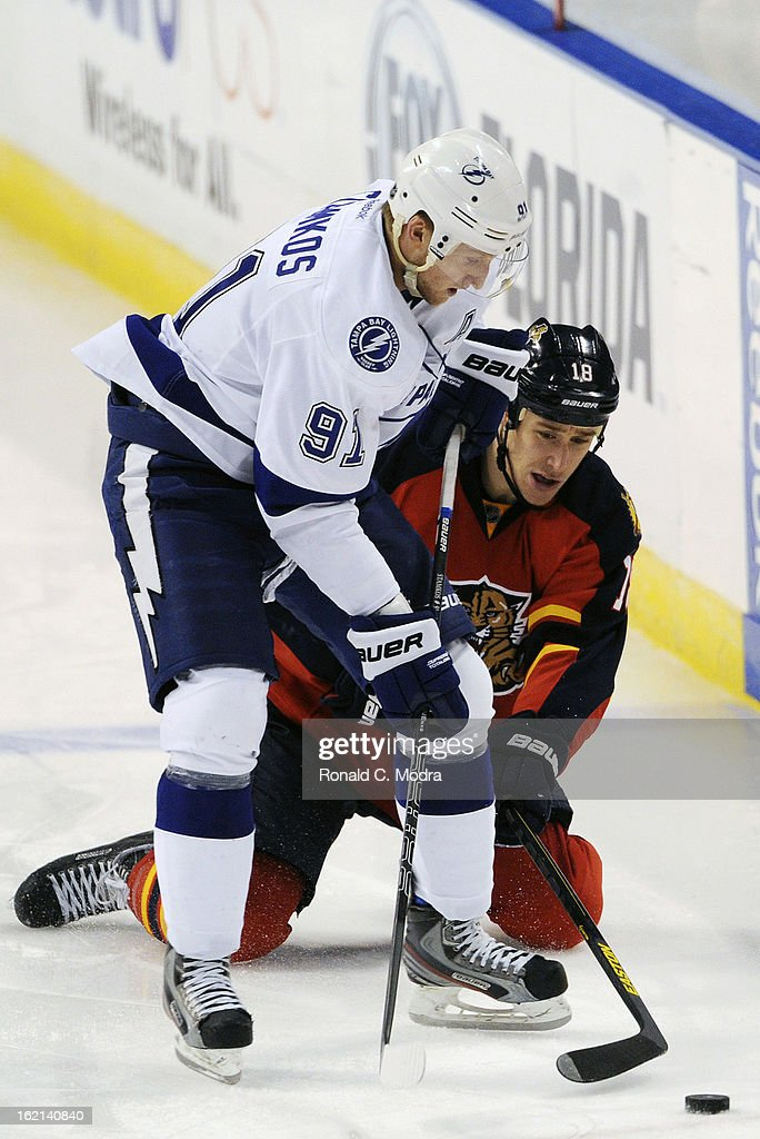 Steven Stamkos #91 of the Tampa Bay Lightning and Shawn Matthias #18 of the Florida Panthers go after the puck during a NHL game at the BB&T Center on February 16, 2013 in Sunrise, Florida.