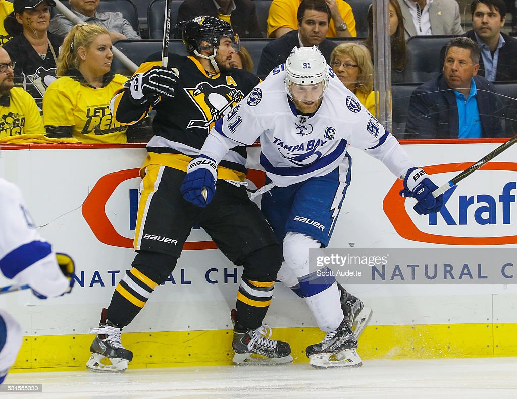Steven Stamkos #91 of the Tampa Bay Lightning battles against Chris Kunitz #14 of the Pittsburgh Penguins during the first period of Game Seven of the Eastern Conference Finals in the 2016 NHL Stanley Cup Playoffs at the Amalie Arena on May 26, 2016 in Tampa, Florida.