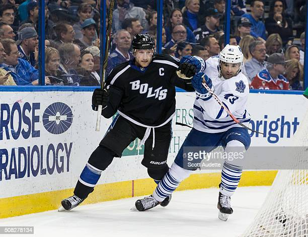 Steven Stamkos of the Tampa Bay Lightning battles against Nazem Kadri of the Toronto Maple Leafs during the third period at the Amalie Arena on...