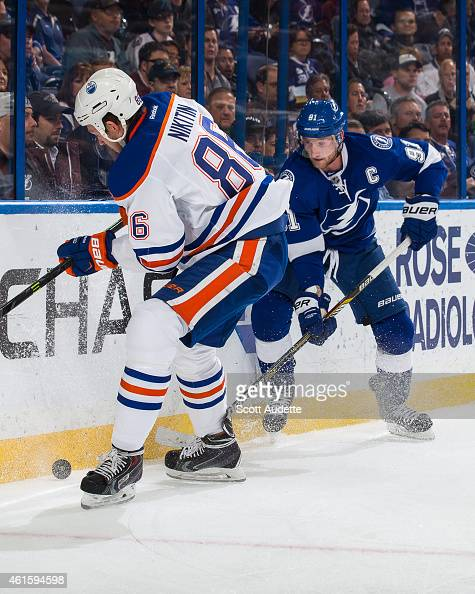 Steven Stamkos of the Tampa Bay Lightning battles for the puck against Nikita Nikitin of the Edmonton Oilers during the first period at the Amalie...