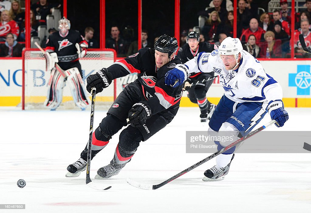 <a gi-track='captionPersonalityLinkClicked' href=/galleries/search?phrase=Steven+Stamkos&family=editorial&specificpeople=4047623 ng-click='$event.stopPropagation()'>Steven Stamkos</a> #91 of the Tampa Bay Lightning battles for the puck with <a gi-track='captionPersonalityLinkClicked' href=/galleries/search?phrase=Jordan+Staal&family=editorial&specificpeople=533044 ng-click='$event.stopPropagation()'>Jordan Staal</a> #11 of the Carolina Hurricanes as they race through the neutral zone during their NHL game on February 23, 2013 at PNC Arena in Raleigh, North Carolina.