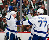 Steven Stamkos of the Tampa Bay Lightning celebrates a goal with teammate Victor Hedman during their NHL game against theVancouver Canucks at Rogers...