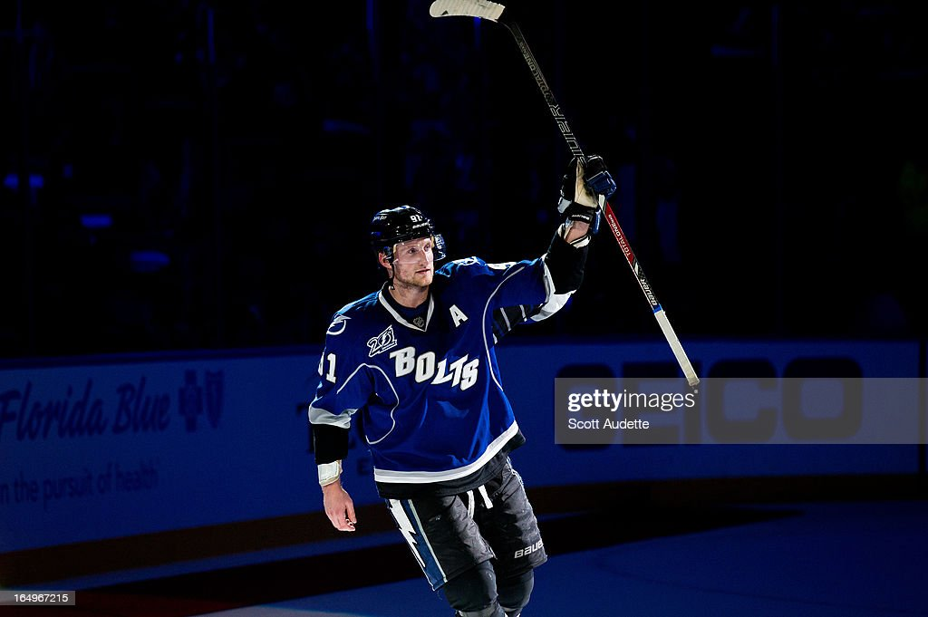 <a gi-track='captionPersonalityLinkClicked' href=/galleries/search?phrase=Steven+Stamkos&family=editorial&specificpeople=4047623 ng-click='$event.stopPropagation()'>Steven Stamkos</a> #91 of the Tampa Bay Lightning celebrates after defeating the New Jersey Devils 5-4 at the Tampa Bay Times Forum on March 29, 2013 in Tampa, Florida.