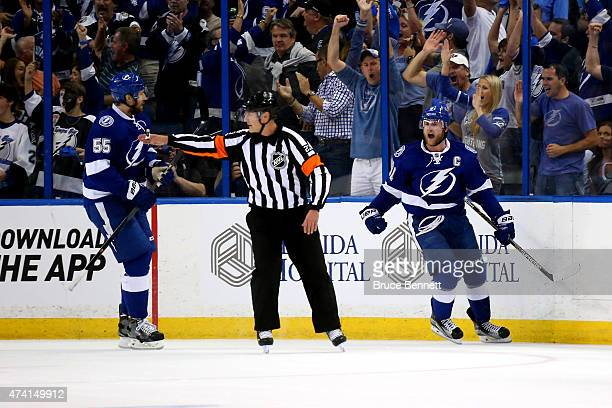 Steven Stamkos of the Tampa Bay Lightning celebrates after scoring a goal in the first period against Henrik Lundqvist of the New York Rangers during...