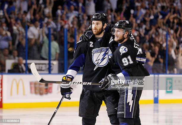 Steven Stamkos of the Tampa Bay Lightning celebrates his goal with teammate Eric Brewer during the third period against the Boston Bruins in Game Six...