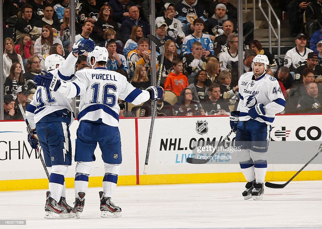 <a gi-track='captionPersonalityLinkClicked' href=/galleries/search?phrase=Steven+Stamkos&family=editorial&specificpeople=4047623 ng-click='$event.stopPropagation()'>Steven Stamkos</a> #91 of the Tampa Bay Lightning celebrates his goal with <a gi-track='captionPersonalityLinkClicked' href=/galleries/search?phrase=Teddy+Purcell&family=editorial&specificpeople=4537302 ng-click='$event.stopPropagation()'>Teddy Purcell</a> #16 and Nate Thompson #44 during the second period against the Pittsburgh Penguins on February 24, 2013 at Consol Energy Center in Pittsburgh, Pennsylvania.
