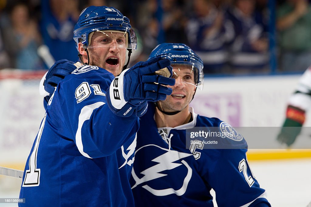 <a gi-track='captionPersonalityLinkClicked' href=/galleries/search?phrase=Steven+Stamkos&family=editorial&specificpeople=4047623 ng-click='$event.stopPropagation()'>Steven Stamkos</a> #91 of the Tampa Bay Lightning celebrates his goal with teammate <a gi-track='captionPersonalityLinkClicked' href=/galleries/search?phrase=Martin+St.+Louis&family=editorial&specificpeople=202067 ng-click='$event.stopPropagation()'>Martin St. Louis</a> #26 during the third period against the Minnesota Wild at the Tampa Bay Times Forum on October 17, 2013 in Tampa, Florida.