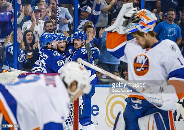 Steven Stamkos of the Tampa Bay Lightning celebrates his goal with teammates Nikita Kucherov and Alex Killorn against Travis Hamonic and goalie...