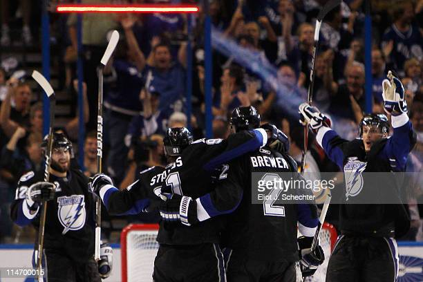 Steven Stamkos of the Tampa Bay Lightning celebrates his third period goal against the Boston Bruins with teammates Simon Gagne Eric Brewer and...