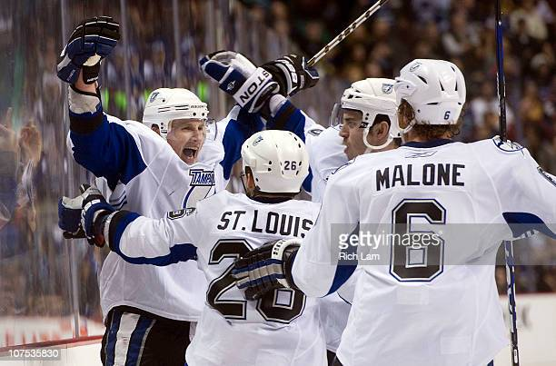 Steven Stamkos of the Tampa Bay Lightning celebrates with Martin St Louis Ryan Malone and Teddy Purcell after scoring against the Vancouver Canucks...