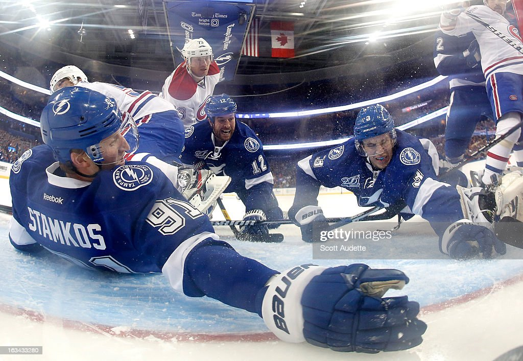 <a gi-track='captionPersonalityLinkClicked' href=/galleries/search?phrase=Steven+Stamkos&family=editorial&specificpeople=4047623 ng-click='$event.stopPropagation()'>Steven Stamkos</a> #91 of the Tampa Bay Lightning chases after a puck knocked in by <a gi-track='captionPersonalityLinkClicked' href=/galleries/search?phrase=Alexei+Emelin&family=editorial&specificpeople=723573 ng-click='$event.stopPropagation()'>Alexei Emelin</a> #74 of the Montreal Canadiens during the third period of the game at the Tampa Bay Times Forum on March 9, 2013 in Tampa, Florida.