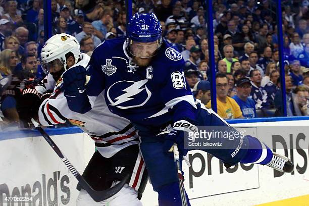 Steven Stamkos of the Tampa Bay Lightning checks Johnny Oduya of the Chicago Blackhawks during Game Five of the 2015 NHL Stanley Cup Final at Amalie...