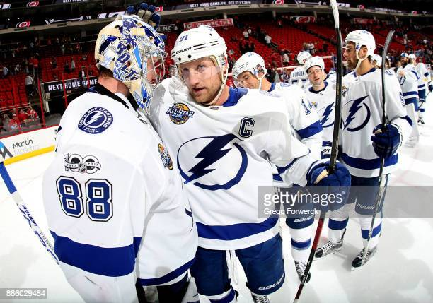 Steven Stamkos of the Tampa Bay Lightning congratulates Andrei Vasilevskiy on his win against the Carolina Hurricanes following an NHL game on...