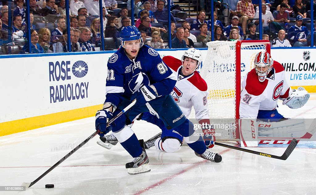 Steven Stamkos #91 of the Tampa Bay Lightning controls the puck during the third period of the game against the Montreal Canadiens at the Tampa Bay Times Forum on February 12, 2013 in Tampa, Florida.